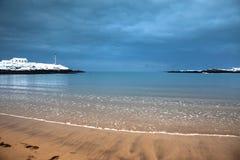 Snow on Trearddur Bay Beach Stock Image
