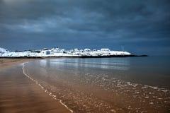 Snow on Trearddur Bay Beach Stock Photography