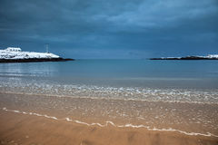 Snow on Trearddur Bay Beach in winter Isle of Anglesey North Wal Royalty Free Stock Photo