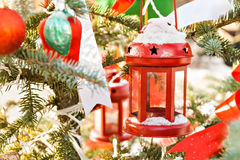 Snow tree decorated with red candlestick, toys and tapes Royalty Free Stock Photos