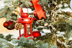 Snow tree decorated with red candlestick, toys and tapes Stock Photography