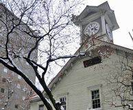 Snow on tree at wooden Clock tower in Sapporo town Royalty Free Stock Photo