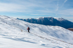 Snow trekking and distant mountains Stock Photography