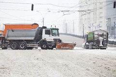 Snow trucks streets of a big city Royalty Free Stock Photography
