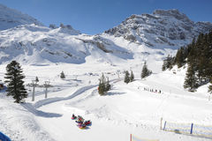 Snow tubing at Engelberg Royalty Free Stock Images