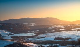 Snow in Tuscany. Winter panorama view at sunset. Siena, Italy. Snow in Tuscany, winter panorama at sunset. Radicondoli, Siena, Italy Europe Royalty Free Stock Image