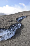 Snow under the lava of Etna. Sicily. Italy. Stock Images