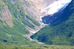 Snow and Valley. Snow in valley of Alaskan mountain stock images