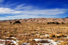 Snow and vegetation at great sand dunes national park Stock Photos