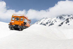 Snow Vehicle in Mountains Stock Photography