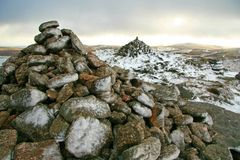 Snow on the view points. Snow covering the stones on the top of a hill Royalty Free Stock Photos
