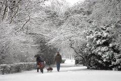 Snow walk. Family of four enjoying a walk in the snow Stock Photo