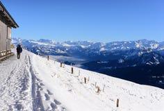 Snow walking path with snow mountains, the Rigi Kulm. Snow walking path with snow mountains and blue sky; the Rigi Kulm in winter, Lucerne, Switzerland stock photos
