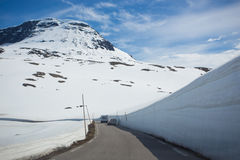 Snow walls around a mountain road Royalty Free Stock Photos