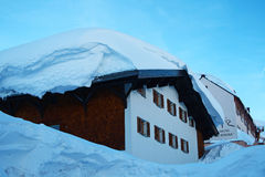 Snow Wave. Snow cornice on the roof at St.Christoph am Arlberg in Tyrol Austria Royalty Free Stock Photo