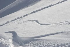 Snow waves. Two wavy tracks on the powder Royalty Free Stock Image