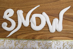 Snow whipped cream inscription Stock Photography