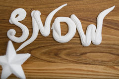 Snow whipped cream inscription Stock Images