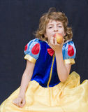 Snow white. Little beautiful child dressed as snow white eating the apple Stock Photos
