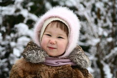 Snow White. 2 years old girl in winter Royalty Free Stock Image