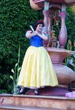 Snow White Character on Float in Disneyland Fantasy Parade. Snow White atop a float in Disneyland`s very popular Fantasy Parade. The characters are a delight to Stock Photo