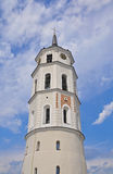 Snow-white bell tower in Vilnius on the background of blue sky Stock Photos