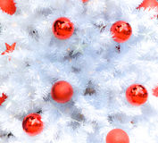 Snow white christmas tree with decoration. White christmas tree with decoration during winter Royalty Free Stock Photography