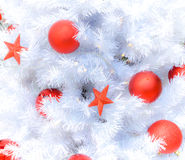 Snow white christmas tree with decoration. White christmas tree with decoration during winter Royalty Free Stock Image