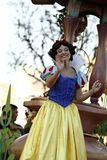 Snow White in Disneyland Parade. Snow White smiles and waves at  crowd during Disneyland parade in Anaheim California stock photography