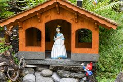 Snow White and Dwarfs on a garden of a house Royalty Free Stock Photography