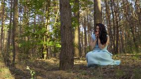 Snow White eat poisoned apple and dying. Snow White picks plants in the forest. Suddenly girl finds a red apple. Beautiful girl eats poisoned apple and falls stock video footage