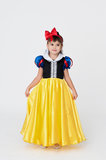 Snow White fancy dress. Pretty girl wearing Snow White fancy dress for a costume party isolated on white Royalty Free Stock Images