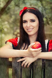 Snow White Holding a Red Apple Fairy Tale Portrait Royalty Free Stock Photo