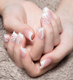 Snow White manicure on female hands. Winter nail design. Stock Photos