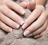 Snow White manicure on female hands. Winter nail design. Royalty Free Stock Photography