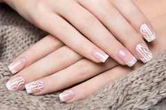 Snow White manicure on female hands. Winter nail design. Stock Image