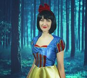 Snow White in the mysterious forest. Artistic processing.  stock photo