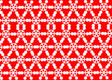 Snow white patterns on red background. Stock Photography