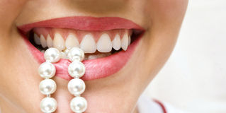 Snow-white pearls of teeth Royalty Free Stock Photo