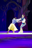 Snow White and Prince Charming Skating Fast Stock Image