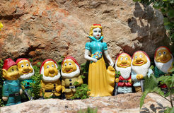 Snow White and the Seven Dwarfs. Clay figurines of Snow White and the Seven Dwarves, standing between the stones Royalty Free Stock Photos