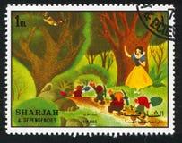 Snow White. SHARJAH AND DEPENDENCIES - CIRCA 1972: stamp printed by Sharjah and Dependencies, shows Snow White and Seven Dwarfs, circa 1972 royalty free stock photo
