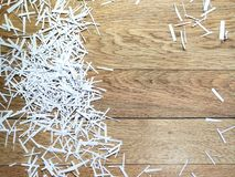 White paper shavings on a wood background royalty free stock images