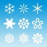 Snow - White Snowflakes On Blue Stock Photo