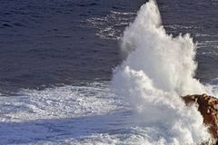Snow White Spray of Sea Water going up twenty meters. Snow White Spray of Sea Water going up twenty meters above the rock it hit stock photos