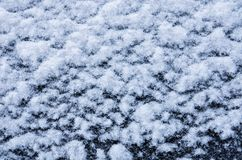 Snow white texture on black background in the form of flakes stock photography