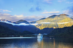 Snow-white tourist boat lit rising sun Stock Photos