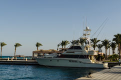 Snow white yacht on the quay. Hurghada, Egypt. Yachts anchored at the port of Hurghada, Egypt Royalty Free Stock Image