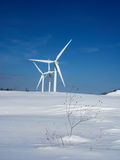 Snow and wind turbines Stock Image