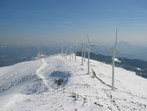 Snow in the Windmill farm. In a sunny day stock images